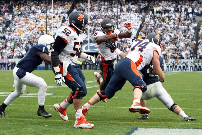 Nov 2, 2013; University Park, PA, USA; Illinois Fighting Illini running back Josh Ferguson (6) leaps into the end zone for a touchdown during the fourth quarter against the Penn State Nittany Lions at Beaver Stadium. Penn State defeated Illinois 24-17. Mandatory Credit: Matthew O'Haren-USA TODAY Sports