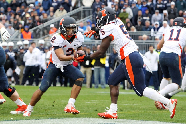 Nov 2, 2013; University Park, PA, USA; Illinois Fighting Illini quarterback Nathan Scheelhaase (2) attempts to hand off to running back Donovonn Young (5) during the fourth quarter against the Penn State Nittany Lions at Beaver Stadium. Penn State defeated Illinois 24-17. Mandatory Credit: Matthew O'Haren-USA TODAY Sports
