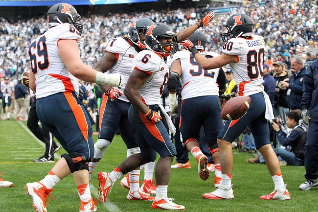 Nov 2, 2013; University Park, PA, USA; Illinois Fighting Illini running back Josh Ferguson (6) celebrates with teammates after scoring a touchdown during the fourth quarter against the Penn State Nittany Lions at Beaver Stadium. Penn State defeated Illinois 24-17. Mandatory Credit: Matthew O'Haren-USA TODAY Sports