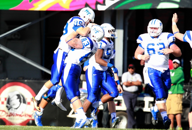 Nov 2, 2013; Birmingham, AL, USA;  Middle Tennessee State Blue Raiders tight end Jacob Corbaley (83) picks up kicker Cody Clark (88) after Clark kicked the winning field goal against the UAB Blazers at Legion Field. The Blue Raiders defeat the Blazers 24-21. Mandatory Credit: Marvin Gentry-USA TODAY Sports