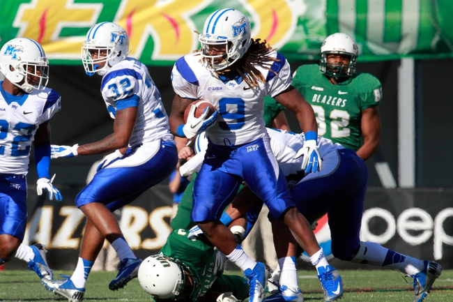 Nov 2, 2013; Birmingham, AL, USA; Middle Tennessee State Blue Raiders wide receiver Kyle Griswold (9) scrambles during a punt return at Legion Field. The Blue Raiders defeat the Blazers 24-21. Mandatory Credit: Marvin Gentry-USA TODAY Sports