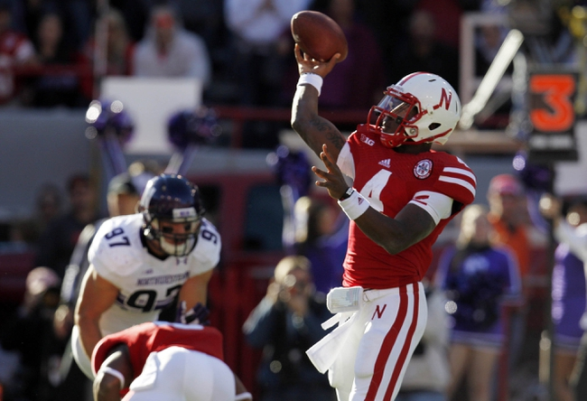 Nov 2, 2013; Lincoln, NE, USA; Nebraska Cornhuskers quarterback Tommy Armstrong Jr. (4) throws against the Northwestern Wildcats in the second quarter at Memorial Stadium. Mandatory Credit: Bruce Thorson-USA TODAY Sports