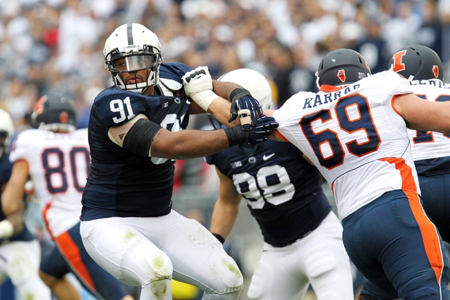Nov 2, 2013; University Park, PA, USA; Penn State Nittany Lions defensive tackle DaQuan Jones (91) drives around Illinois Fighting Illini offensive linesmen Ted Karras (69) during the third quarter at Beaver Stadium. Penn State defeated Illinois 24-17. Mandatory Credit: Matthew O'Haren-USA TODAY Sports