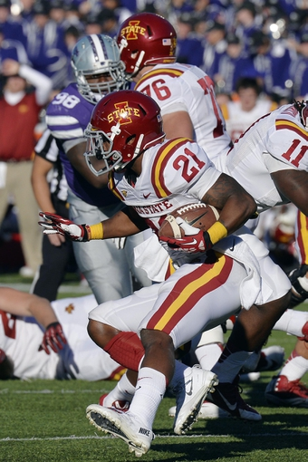 Nov 2, 2013; Manhattan, KS, USA; Iowa State Cyclones running back Shontrelle Johnson (21) runs the ball against the Kansas State Wildcats during the second half at Bill Snyder Family Stadium. The Wildcats defeat the Cyclones 41-7. Mandatory Credit: Jasen Vinlove-USA TODAY Sports