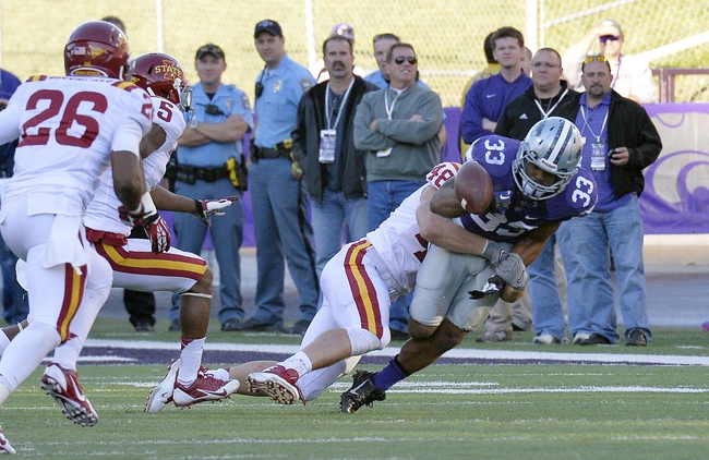 Nov 2, 2013; Manhattan, KS, USA; Iowa State Cyclones defensive end Cory Morrissey (48) forces a fumble by Kansas State Wildcats running back John Hubert (33) during the second half at Bill Snyder Family Stadium. The Wildcats defeat the Cyclones 41-7. Mandatory Credit: Jasen Vinlove-USA TODAY Sports