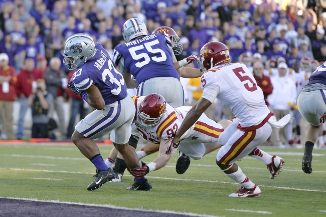 Nov 2, 2013; Manhattan, KS, USA; Kansas State Wildcats running back John Hubert (33) runs for a touchdown against the Iowa State Cyclones during the second half at Bill Snyder Family Stadium. The Wildcats defeat the Cyclones 41-7. Mandatory Credit: Jasen Vinlove-USA TODAY Sports
