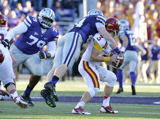 Nov 2, 2013; Manhattan, KS, USA; Kansas State Wildcats defensive end Ryan Mueller (44) sacks Iowa State Cyclones quarterback Grant Rohach (3) during the second half at Bill Snyder Family Stadium. The Wildcats defeat the Cyclones 41-7. Mandatory Credit: Jasen Vinlove-USA TODAY Sports