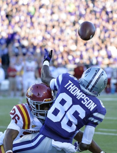 Nov 2, 2013; Manhattan, KS, USA; Kansas State Wildcats wide receiver Tramaine Thompson (86) catches a touchdown pass while being defended by Iowa State Cyclones defensive back Deon Broomfield (26) during the second half at Bill Snyder Family Stadium. The Wildcats defeat the Cyclones 41-7. Mandatory Credit: Jasen Vinlove-USA TODAY Sports