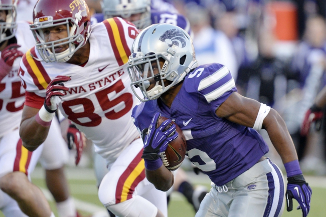 Nov 2, 2013; Manhattan, KS, USA; Kansas State Wildcats running back Robert Rose (5) runs the ball against the Iowa State Cyclones during the second half at Bill Snyder Family Stadium. The Wildcats defeat the Cyclones 41-7. Mandatory Credit: Jasen Vinlove-USA TODAY Sports