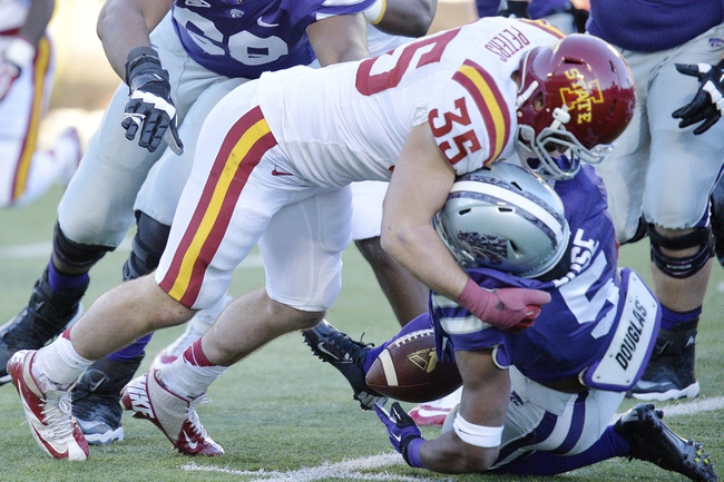 Nov 2, 2013; Manhattan, KS, USA; Iowa State Cyclones defensive back Levi Peters (35) forces a fumble by Kansas State Wildcats running back Robert Rose (5) during the second half at Bill Snyder Family Stadium. The Wildcats defeat the Cyclones 41-7. Mandatory Credit: Jasen Vinlove-USA TODAY Sports