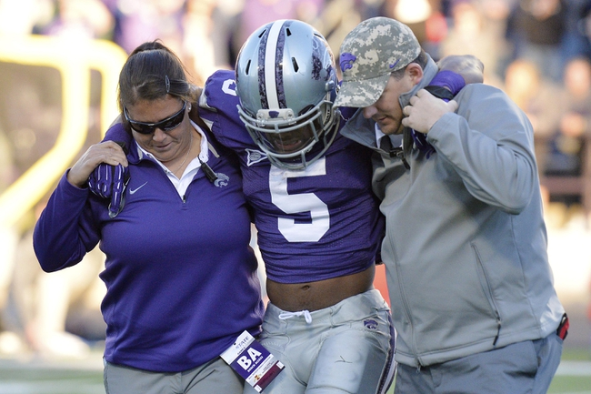 Nov 2, 2013; Manhattan, KS, USA; Kansas State Wildcats running back Robert Rose (5) is helped off the field after being injured on a play against the Iowa State Cyclones during the second half at Bill Snyder Family Stadium. The Wildcats defeat the Cyclones 41-7. Mandatory Credit: Jasen Vinlove-USA TODAY Sports