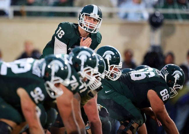 Nov 2, 2013; East Lansing, MI, USA; Michigan State Spartans quarterback Connor Cook (18) changes the play at the line of scrimmage during the 2nd half of a game against the Michigan Wolverines at Spartan Stadium. MSU won 29-6. Mandatory Credit: Mike Carter-USA TODAY Sports