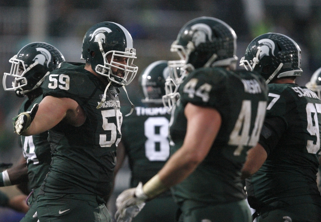 Nov 2, 2013; East Lansing, MI, USA; Michigan State Spartans offensive linesman Dan France (59) celebrates with his teammates during the fourth quarter against the Michigan Wolverines at Spartan Stadium. Spartans beat the Wolverines 29-6. Mandatory Credit: Raj Mehta-USA TODAY Sports