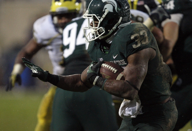 Nov 2, 2013; East Lansing, MI, USA; Michigan State Spartans running back Jeremy Langford (33) runs with the ball during the fourth quarter against the Michigan Wolverines at Spartan Stadium. Spartans beat the Wolverines 29-6. Mandatory Credit: Raj Mehta-USA TODAY Sports