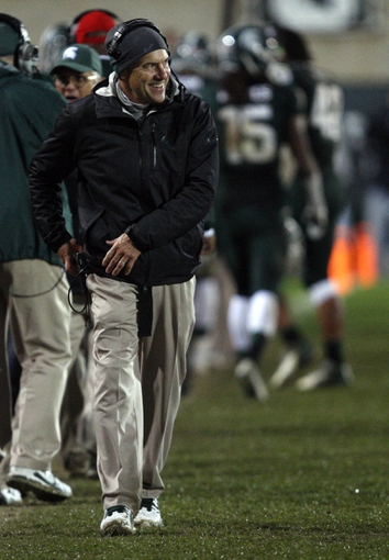 Nov 2, 2013; East Lansing, MI, USA; Michigan State Spartans head coach Mark Dantonio smiles during the fourth quarter against the Michigan Wolverines at Spartan Stadium. Spartans beat the Wolverines 29-6. Mandatory Credit: Raj Mehta-USA TODAY Sports