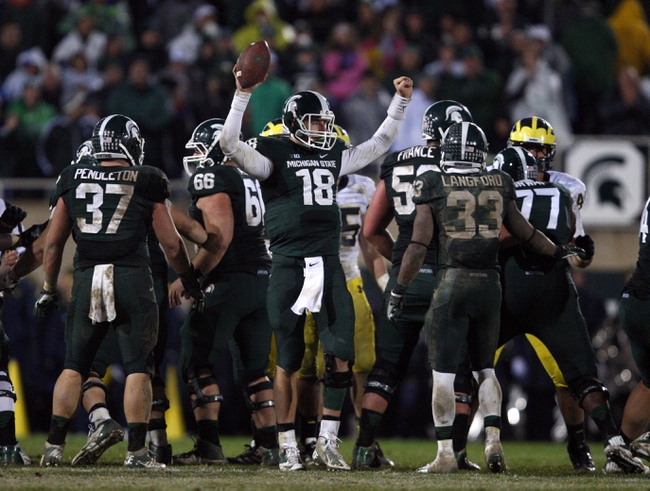 Nov 2, 2013; East Lansing, MI, USA; Michigan State Spartans quarterback Connor Cook (18) celebrates during the fourth quarter against the Michigan Wolverines at Spartan Stadium. Spartans beat the Wolverines 29-6. Mandatory Credit: Raj Mehta-USA TODAY Sports