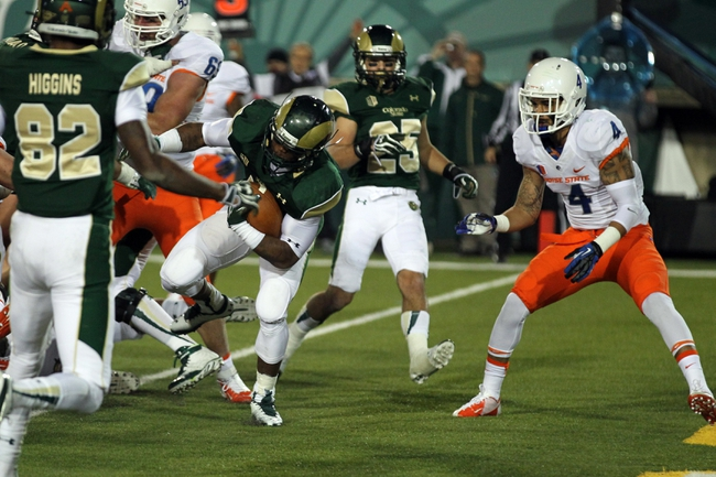 Nov 2, 2013; Fort Collins, CO, USA; Colorado State Rams running back Kapri Bibbs (5) scores a touchdown against Boise State Broncos safety Darian Thompson (4) during the first quarter at Hughes Stadium. Mandatory Credit: Troy Babbitt-USA TODAY Sports