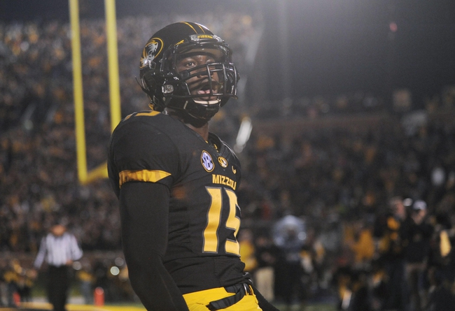 Nov 2, 2013; Columbia, MO, USA; Missouri Tigers wide receiver Dorial Green-Beckham (15) celebrates after scoring a touchdown during the first half of the game against the Tennessee Volunteers at Faurot Field. Mandatory Credit: Denny Medley-USA TODAY Sports
