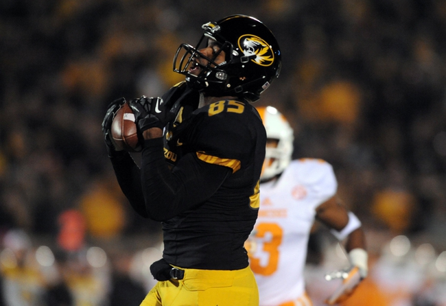 Nov 2, 2013; Columbia, MO, USA; Missouri Tigers wide receiver Marcus Lucas (85) catches a pass for a touchdown during the first half of the game against the Tennessee Volunteers at Faurot Field. Mandatory Credit: Denny Medley-USA TODAY Sports