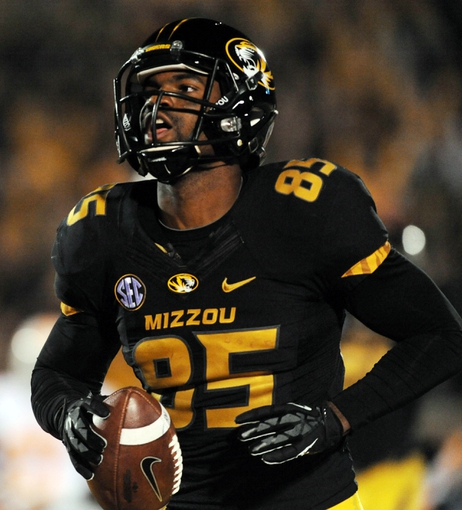 Nov 2, 2013; Columbia, MO, USA; Missouri Tigers wide receiver Marcus Lucas (85) catches a pass and runs in for a touchdown during the first half of the game against the Tennessee Volunteers at Faurot Field. Mandatory Credit: Denny Medley-USA TODAY Sports