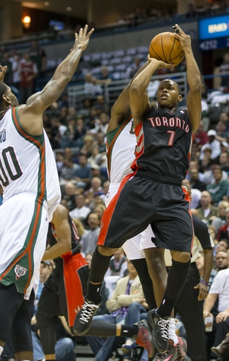 Nov 2, 2013; Milwaukee, WI, USA; Toronto Raptors guard Kyle Lowry (7) shoots during the second quarter against the Milwaukee Bucks at BMO Harris Bradley Center. Mandatory Credit: Jeff Hanisch-USA TODAY Sports
