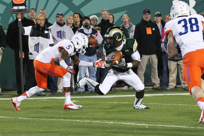 Nov 2, 2013; Fort Collins, CO, USA; Colorado State Rams wide receiver Charles Lovett (4) scores a touchdown against Boise State Broncos cornerback Donte Deayon (5) during the second quarter at Hughes Stadium. Mandatory Credit: Troy Babbitt-USA TODAY Sports