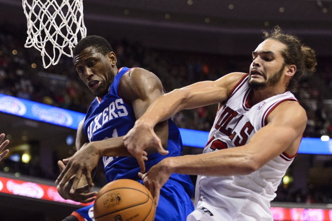 Nov 2, 2013; Philadelphia, PA, USA; Philadelphia 76ers forward Thaddeus Young (21) and Chicago Bulls center Joakim Noah (13) are unable to handle a rebound during the fourth quarter at Wells Fargo Center. The Sixers defeated the Bulls 107-104. Mandatory Credit: Howard Smith-USA TODAY Sports