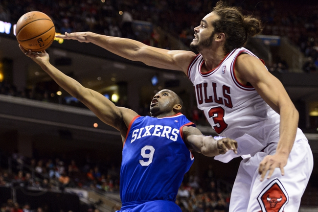 Nov 2, 2013; Philadelphia, PA, USA; Philadelphia 76ers guard James Anderson (9) shoots under pressure from Chicago Bulls center Joakim Noah (13) during the fourth quarter at Wells Fargo Center. The Sixers defeated the Bulls 107-104. Mandatory Credit: Howard Smith-USA TODAY Sports