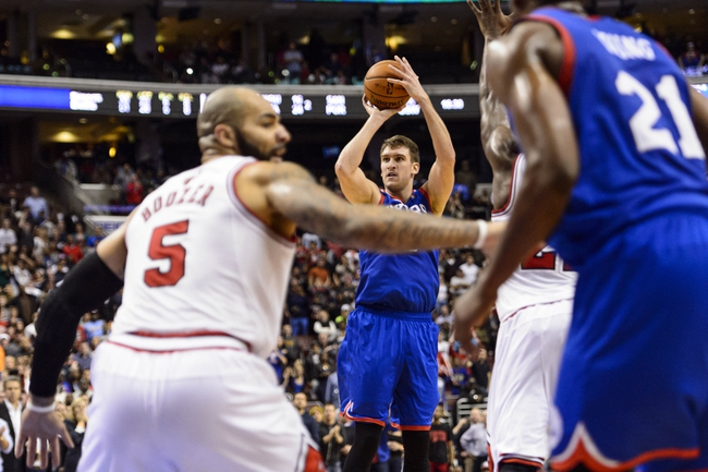 Nov 2, 2013; Philadelphia, PA, USA; Philadelphia 76ers center Spencer Hawes (00) makes a basket late in the fourth quarter against the Chicago Bulls at Wells Fargo Center. The Sixers defeated the Bulls 107-104. Mandatory Credit: Howard Smith-USA TODAY Sports