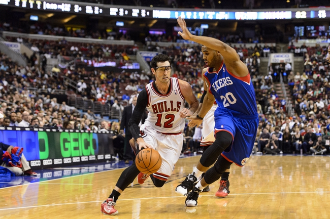 Nov 2, 2013; Philadelphia, PA, USA; Chicago Bulls guard Kirk Hinrich (12) is defended by Philadelphia 76ers forward Brandon Davies (20) during the third quarter at Wells Fargo Center. The Sixers defeated the Bulls 107-104. Mandatory Credit: Howard Smith-USA TODAY Sports