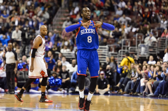 Nov 2, 2013; Philadelphia, PA, USA; Philadelphia 76ers guard Tony Wroten (8) celebrates making a three point shot during the third quarter against the Chicago Bulls at Wells Fargo Center. The Sixers defeated the Bulls 107-104. Mandatory Credit: Howard Smith-USA TODAY Sports