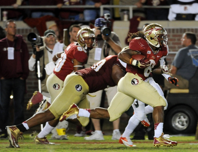 Nov 2, 2013; Tallahassee, FL, USA; Florida State Seminoles running back Devonta Freeman (8) runs the ball for a touchdown against the Miami Hurricanes during the first half at Doak Campbell Stadium. Mandatory Credit: Melina Vastola-USA TODAY Sports