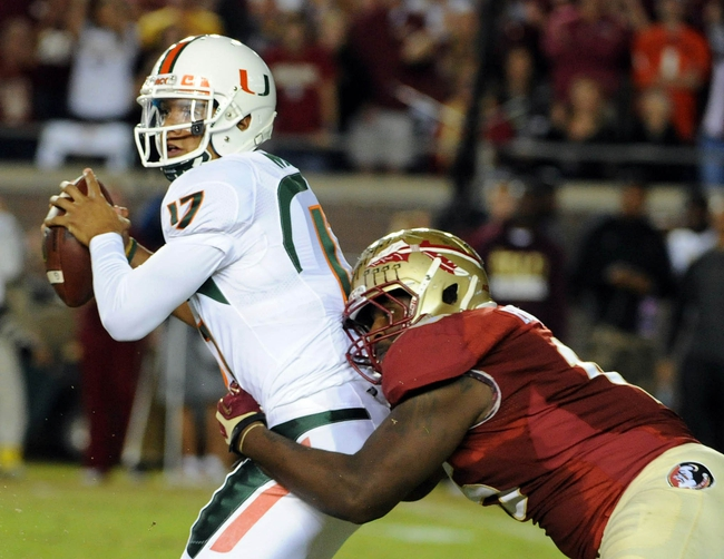 Nov 2, 2013; Tallahassee, FL, USA; Miami Hurricanes quarterback Stephen Morris (17) is sacked by Florida State Seminoles defensive end Mario Edwards Jr. (15) during the first half at Doak Campbell Stadium. Mandatory Credit: Melina Vastola-USA TODAY Sports