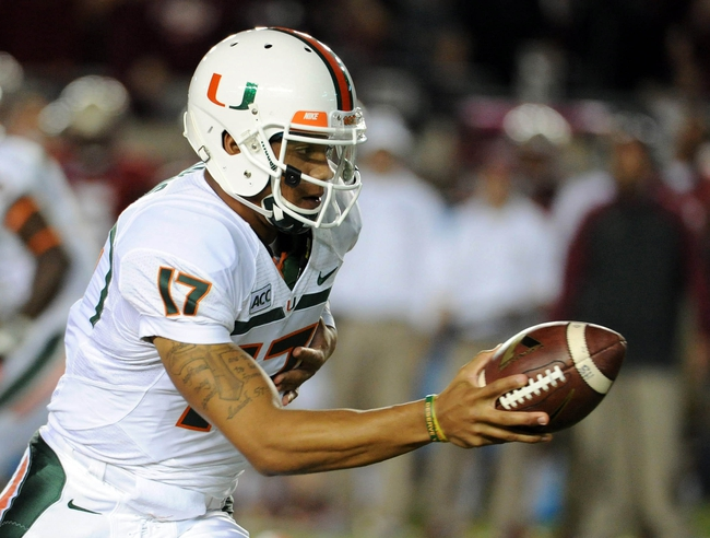 Nov 2, 2013; Tallahassee, FL, USA; Miami Hurricanes quarterback Stephen Morris (17) looks to hand off the ball during the first half against the Florida State Seminoles at Doak Campbell Stadium. Mandatory Credit: Melina Vastola-USA TODAY Sports