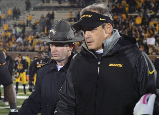 Nov 2, 2013; Columbia, MO, USA; Missouri Tigers head coach Gary Pinkel walks on the field to congratulate Tennessee Volunteers head coach Butch Jones (not pictured) after the game at Faurot Field. Missouri won 31-3. Mandatory Credit: Denny Medley-USA TODAY Sports