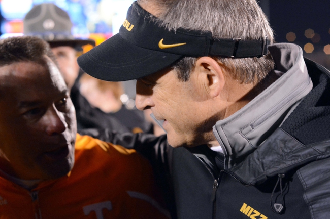 Nov 2, 2013; Columbia, MO, USA; Missouri Tigers head coach Gary Pinkel talks to Tennessee Volunteers head coach Butch Jones after  the game at Faurot Field. Missouri won 31-3. Mandatory Credit: Denny Medley-USA TODAY Sports
