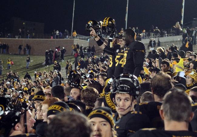 Nov 2, 2013; Columbia, MO, USA; Missouri Tigers players celebrate in the stands with fans after the game against the Tennessee Volunteers at Faurot Field. Missouri won 31-3. Mandatory Credit: Denny Medley-USA TODAY Sports