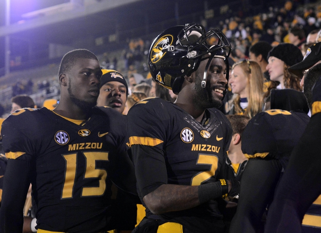 Nov 2, 2013; Columbia, MO, USA; Missouri Tigers wide receiver L'Damian Washington (2) and wide receiver Dorial Green-Beckham (15) celebrate in the stands with fans after the game against the Tennessee Volunteers at Faurot Field. Missouri won 31-3. Mandatory Credit: Denny Medley-USA TODAY Sports