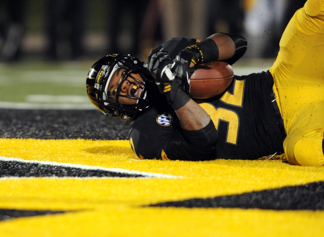 Nov 2, 2013; Columbia, MO, USA; Missouri Tigers running back Russell Hansbrough (32) runs in for a touchdown during the second half of the game against the Tennessee Volunteers at Faurot Field. Missouri won 31-3. Mandatory Credit: Denny Medley-USA TODAY Sports