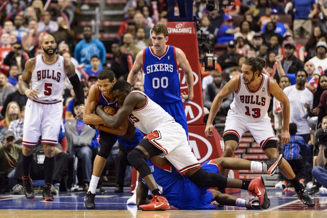 Nov 2, 2013; Philadelphia, PA, USA; Philadelphia 76ers guard Michael Carter-Williams (1) fights for a loose ball with Chicago Bulls forward Luol Deng (9) during the fourth quarter at Wells Fargo Center. The Sixers defeated the Bulls 107-104. Mandatory Credit: Howard Smith-USA TODAY Sports