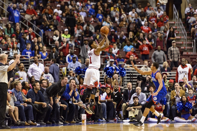 Nov 2, 2013; Philadelphia, PA, USA; Chicago Bulls guard Derrick Rose (1) shoots a jump shot as Philadelphia 76ers guard Michael Carter-Williams (1) defends during the fourth quarter at Wells Fargo Center. The Sixers defeated the Bulls 107-104. Mandatory Credit: Howard Smith-USA TODAY Sports