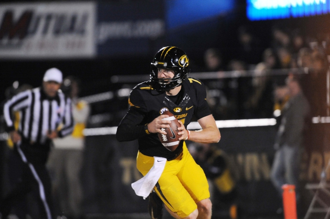 Nov 2, 2013; Columbia, MO, USA; Missouri Tigers quarterback Maty Mauk (7) runs the ball during the second half of the game against the Tennessee Volunteers at Faurot Field. Missouri won 31-3. Mandatory Credit: Denny Medley-USA TODAY Sports