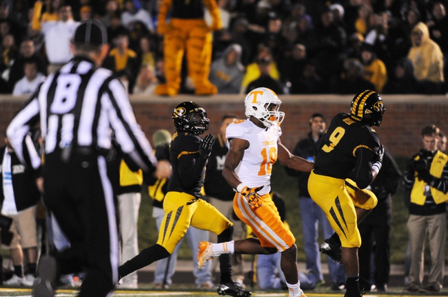 Nov 2, 2013; Columbia, MO, USA; Missouri Tigers safety Braylon Webb (9) intercepts the ball at the one yard line as Tennessee Volunteers wide receiver Jason Croom (18) pushes him out of bounds during the second half of the game at Faurot Field. Missouri won 31-3. Mandatory Credit: Denny Medley-USA TODAY Sports