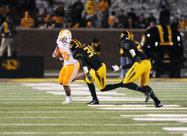 Nov 2, 2013; Columbia, MO, USA; Tennessee Volunteers running back Rajion Neal (20) runs the ball as Missouri Tigers defensive back E.J. Gaines (31) attempts the tackle during the second half of the game at Faurot Field. Missouri won 31-3. Mandatory Credit: Denny Medley-USA TODAY Sports