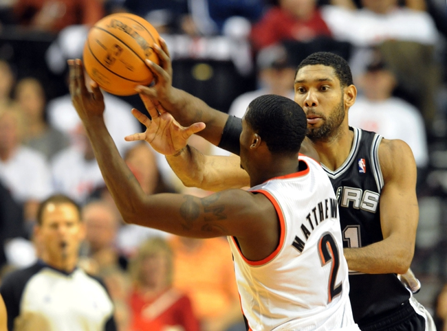 Nov 2, 2013; Portland, OR, USA; San Antonio Spurs power forward Tim Duncan (21) defends Portland Trail Blazers shooting guard Wesley Matthews (2) during the first quarter of the game at the Moda Center. Mandatory Credit: Steve Dykes-USA TODAY Sports