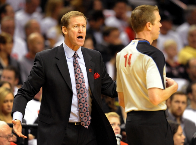 Nov 2, 2013; Portland, OR, USA; Portland Trail Blazers head coach Terry Stotts has some words with referee Ed Malloy (14) during the first quarter of the game against the San Antonio Spurs at the Moda Center. Mandatory Credit: Steve Dykes-USA TODAY Sports