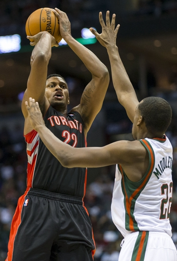 Nov 2, 2013; Milwaukee, WI, USA; Toronto Raptors forward Rudy Gay (22) shoots over Milwaukee Bucks forward Khris Middleton (22) during the second quarter at BMO Harris Bradley Center. Mandatory Credit: Jeff Hanisch-USA TODAY Sports
