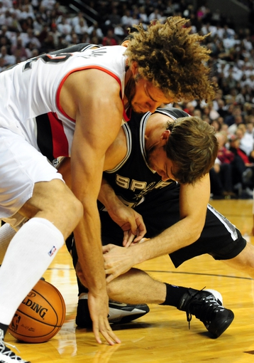 Nov 2, 2013; Portland, OR, USA; Portland Trail Blazers center Robin Lopez (42) battles for a loose ball with San Antonio Spurs center Tiago Splitter (22) during the first quarter of the game at  the Moda Center. Mandatory Credit: Steve Dykes-USA TODAY Sports