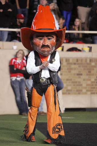 Nov 2, 2013; Lubbock, TX, USA; The Oklahoma State Cowboys mascot Pistol Pete on the sidelines during the game with the Texas Tech Red Raiders at Jones AT&T Stadium. Mandatory Credit: Michael C. Johnson-USA TODAY Sports