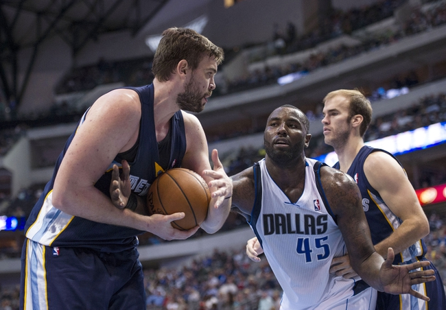 Nov 2, 2013; Dallas, TX, USA; Memphis Grizzlies center Marc Gasol (33) and Dallas Mavericks center DeJuan Blair (45) fight for the ball during the second half at the American Airlines Center. The Mavericks defeated the Grizzlies 111-99. Mandatory Credit: Jerome Miron-USA TODAY Sports